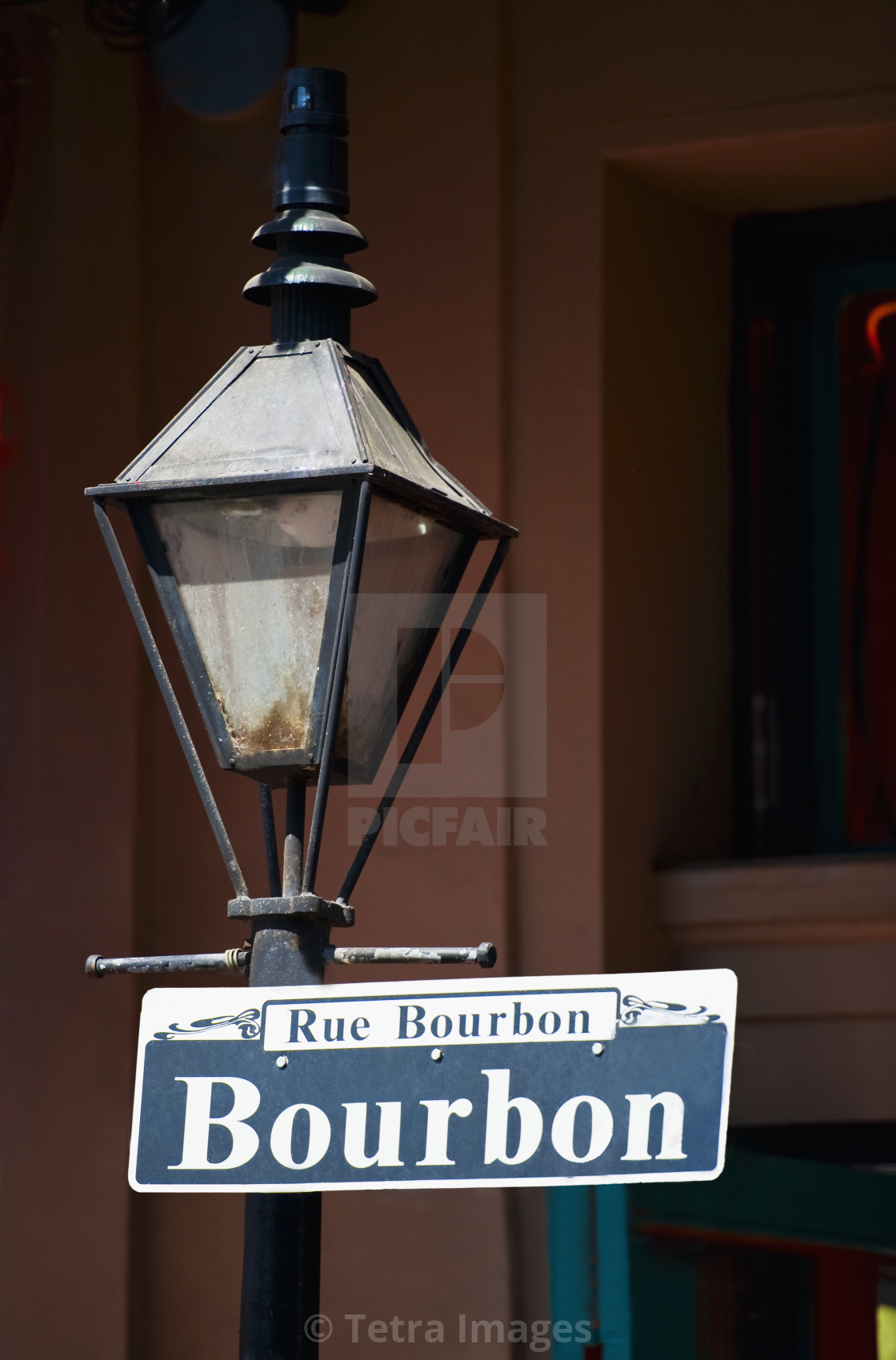 Lamp Post And Bourbon Street Sign In New Orleans License Download
