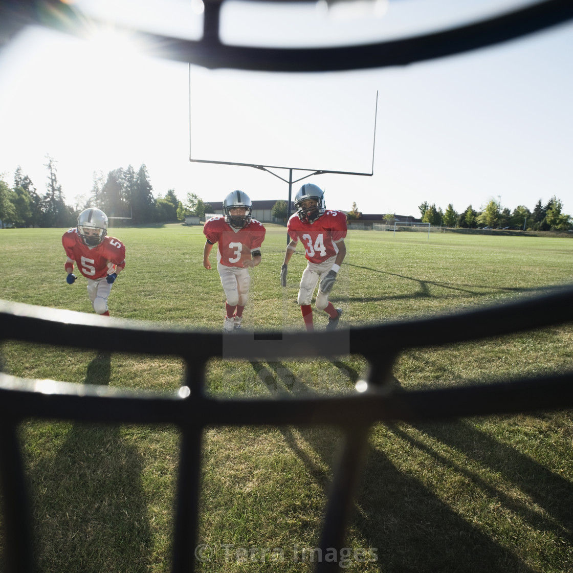 """""""View of football players and field from inside helmet"""" stock image"""