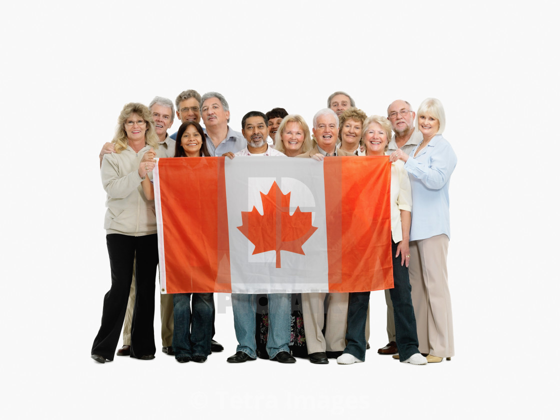 Group Of People Holding A Canadian Flag License Download Or Print