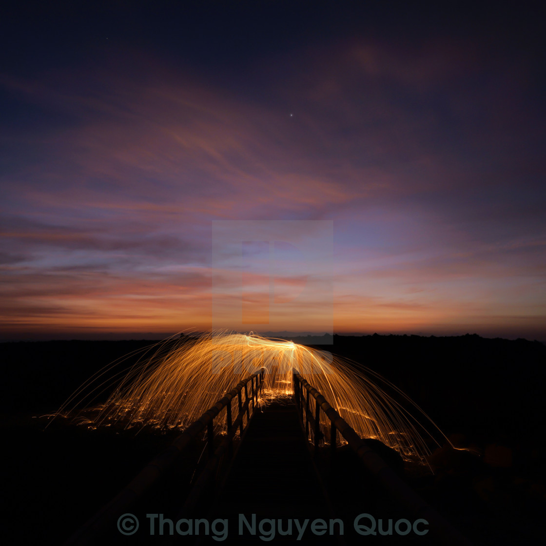 """Fire on bamboo bridge"" stock image"