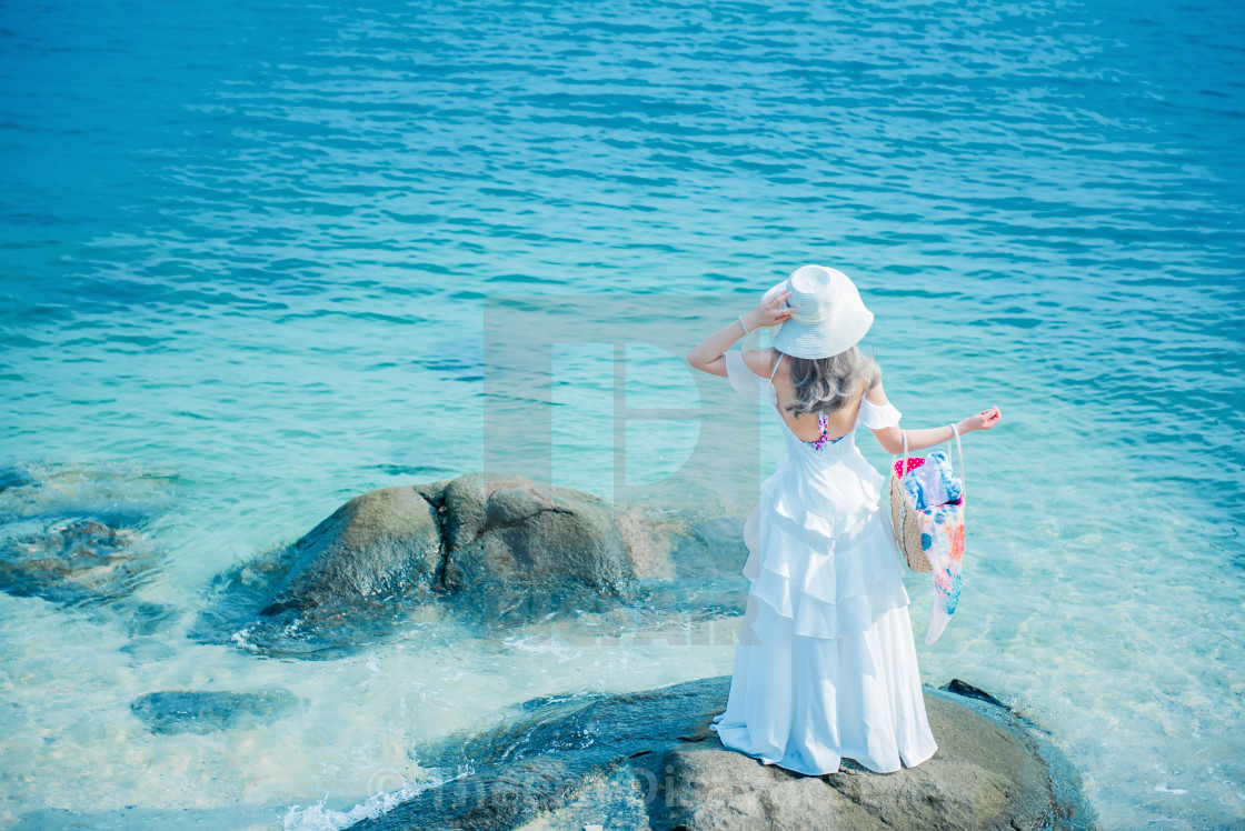 """Women travel alone at the sea and beach on Summer. Sad and lonely."" stock image"