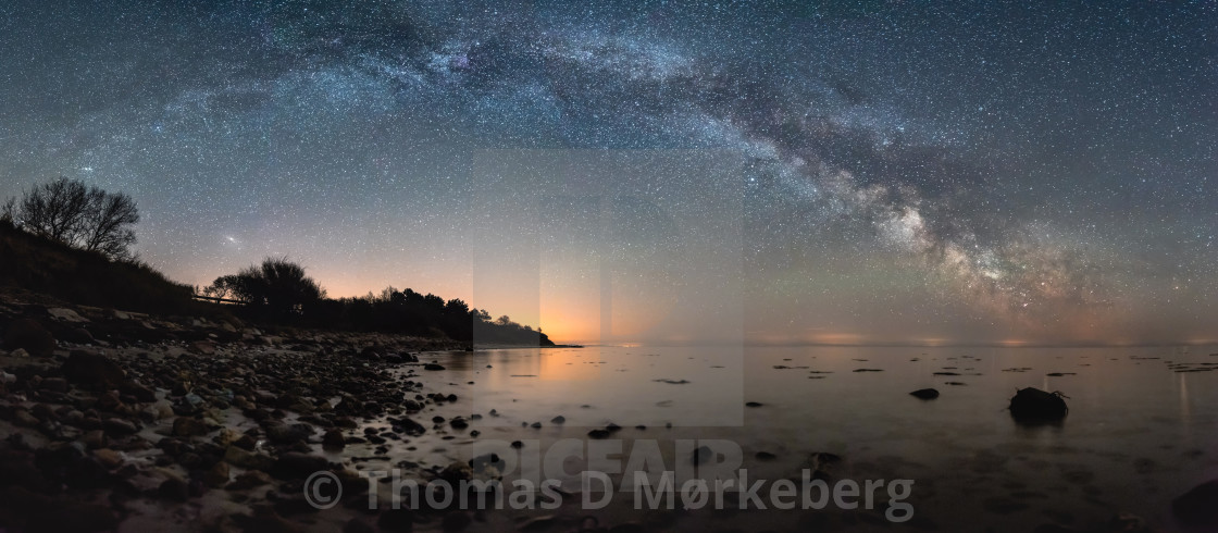 """Milky way arc over beach"" stock image"