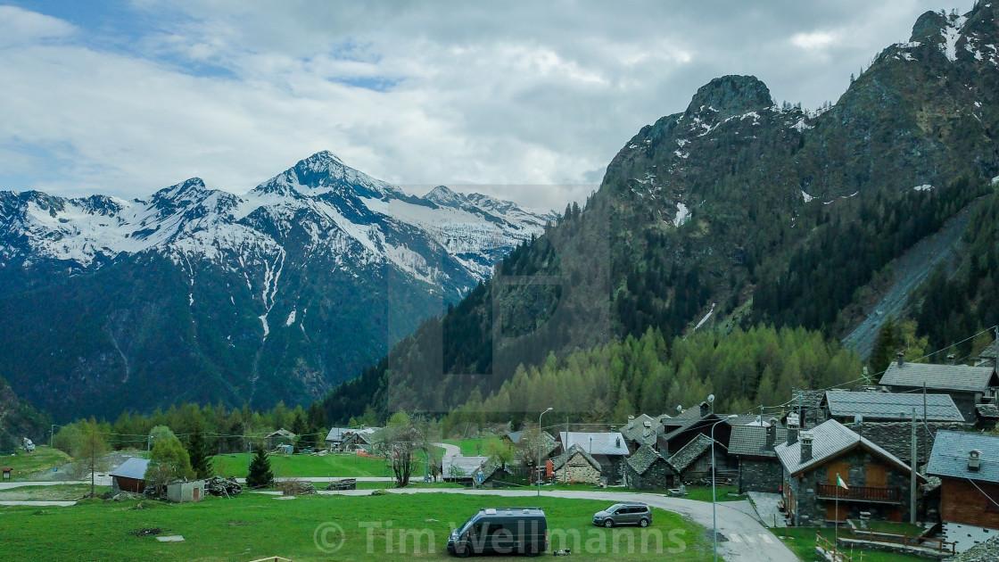 italy alps mountain snow camping vanlife village drone