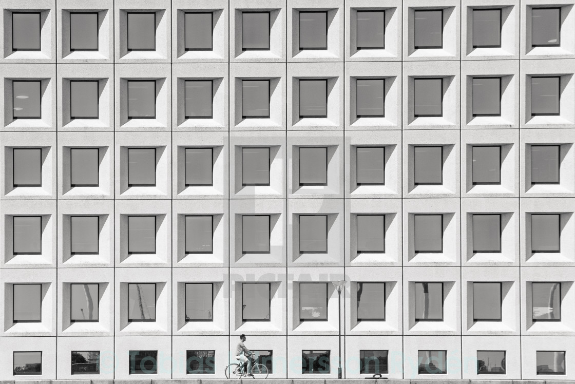 """Bicycle in front of windows"" stock image"
