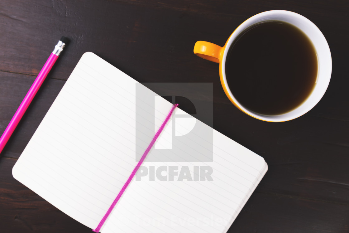 """Coffee cup and open notebook"" stock image"