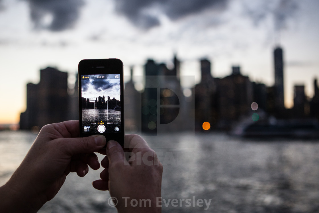 """Taking photo of Manhattan skyline"" stock image"