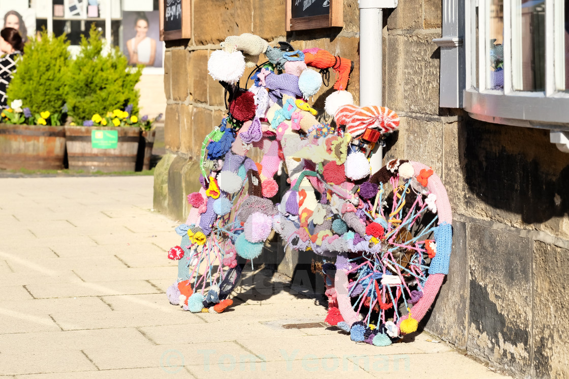 """Tour de Yorkshire 2016 a 'yarn bombed' bicycle in the North Yorkshire town of Stokesley wide 2"" stock image"