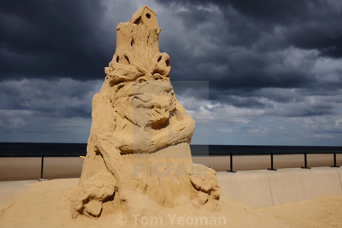 """Sand sculpture under stormy sky"" stock image"