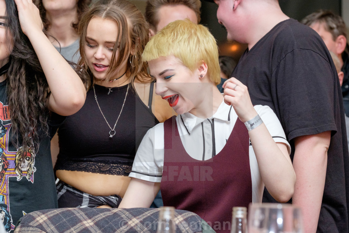 """Young people having fun at music gig"" stock image"