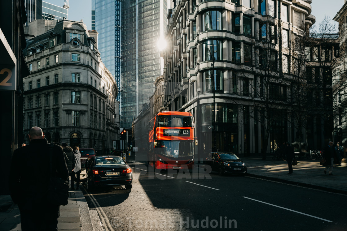 """Sun light in London street with red bus"" stock image"
