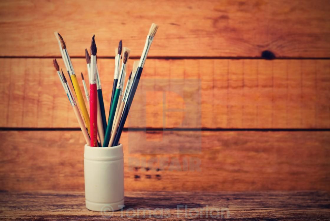 """""""Vintage retro photo of jar with paintbrushes"""" stock image"""