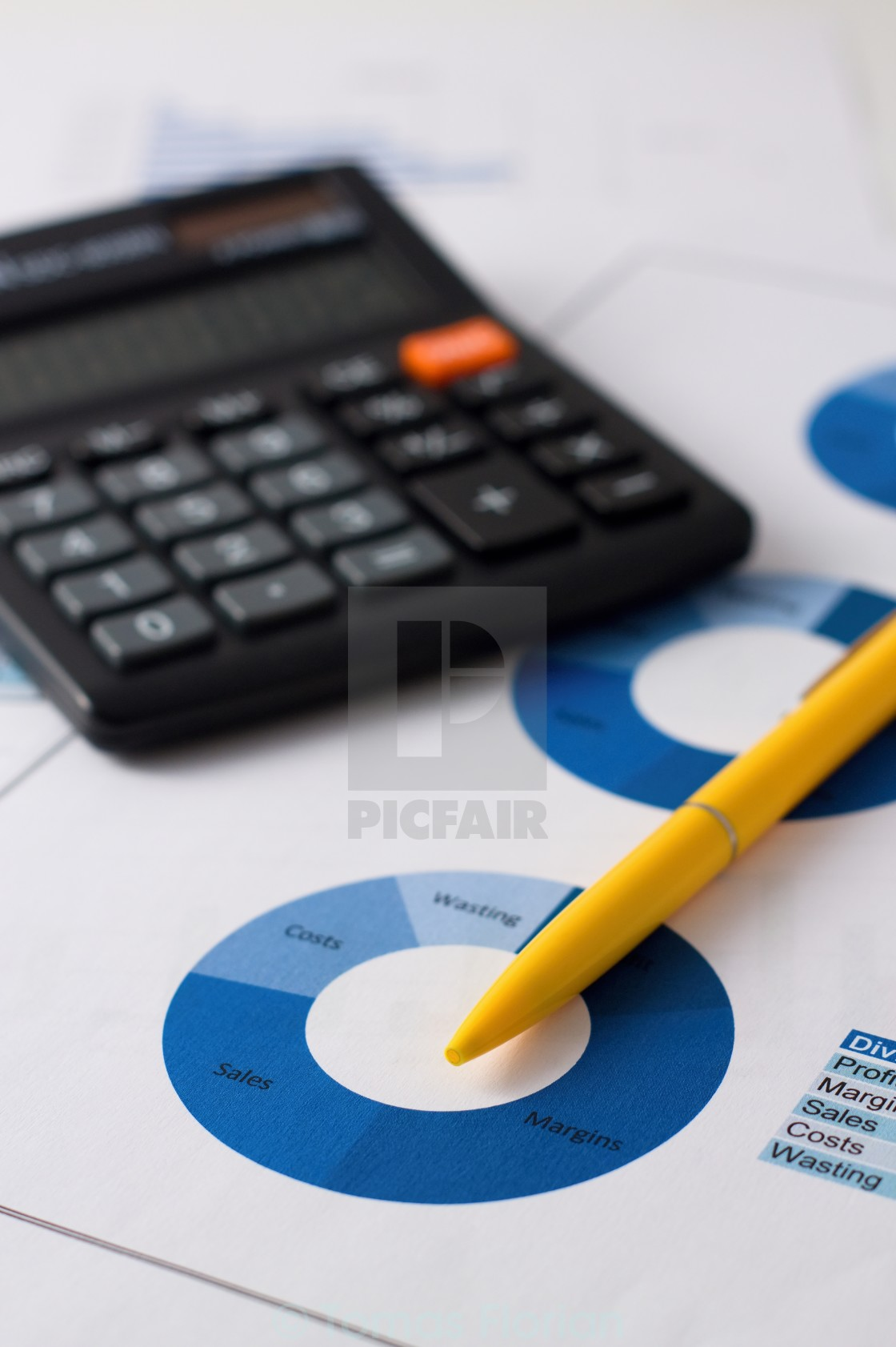 """""""Yellow pencil placed on blue pie chart"""" stock image"""