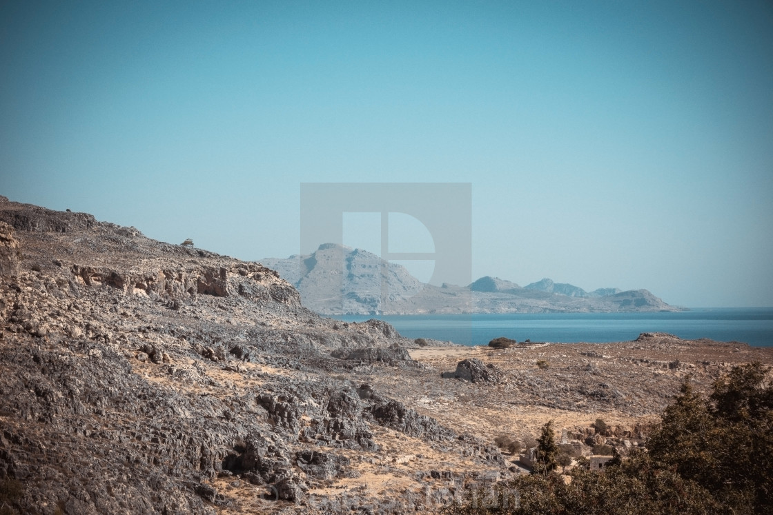 """Rocks and hills on Rhodes island near Lindos town"" stock image"