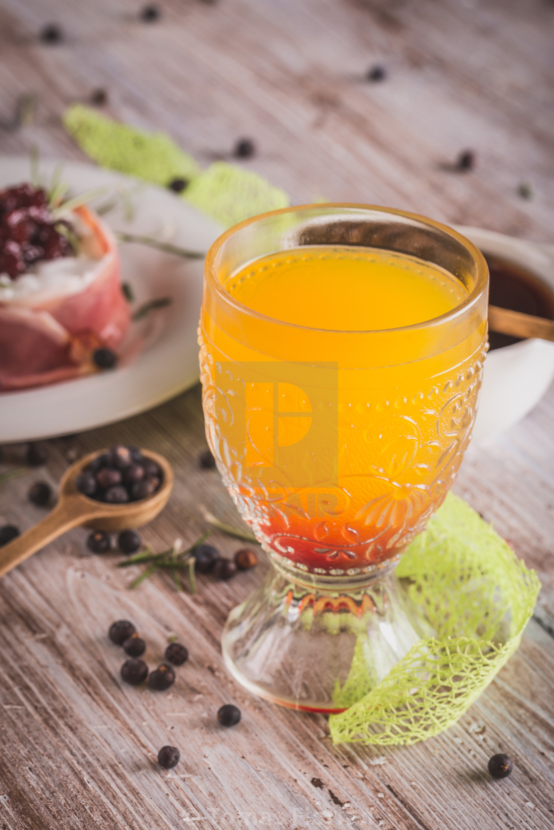 """Glass with orange juice on wooden board with whole camembert"" stock image"