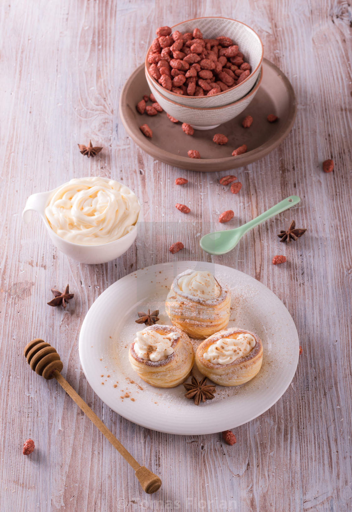 """""""Sweet dessert from puff pastry filled by curd cheese on wooden board"""" stock image"""