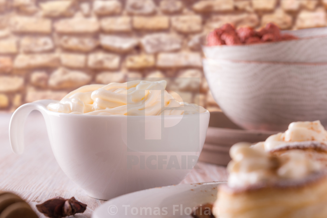 """""""White cup full of sweet curd cheese on wooden board"""" stock image"""