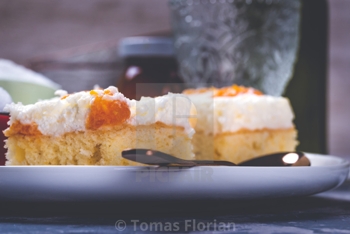 """Few pieces of cake with cream topping with pieces of tangerines"" stock image"