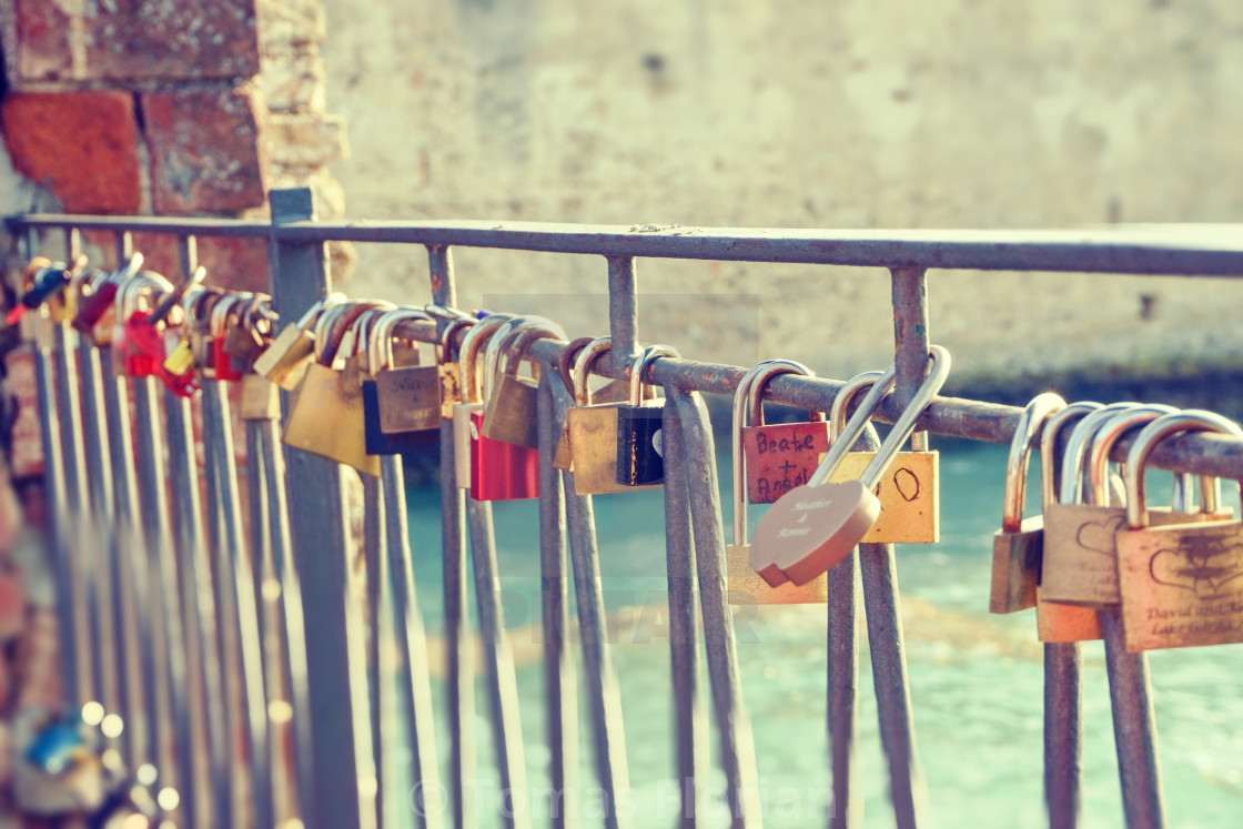 """""""Vintage photo of several metal locks fixed to fence in Sirmione"""" stock image"""