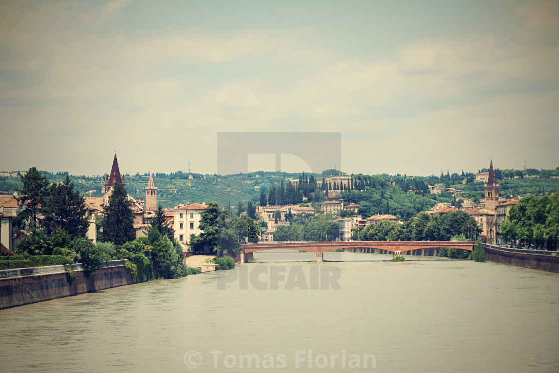 """View on Adige river which goes through Verona city"" stock image"