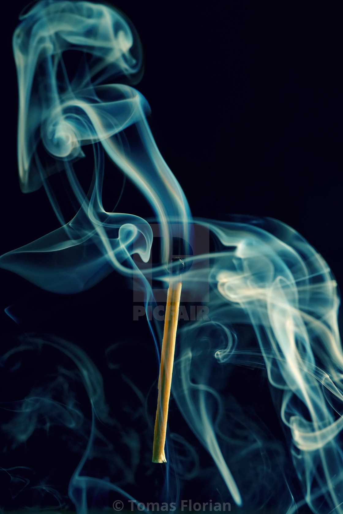 """Match stick with burnt head and smoke around"" stock image"
