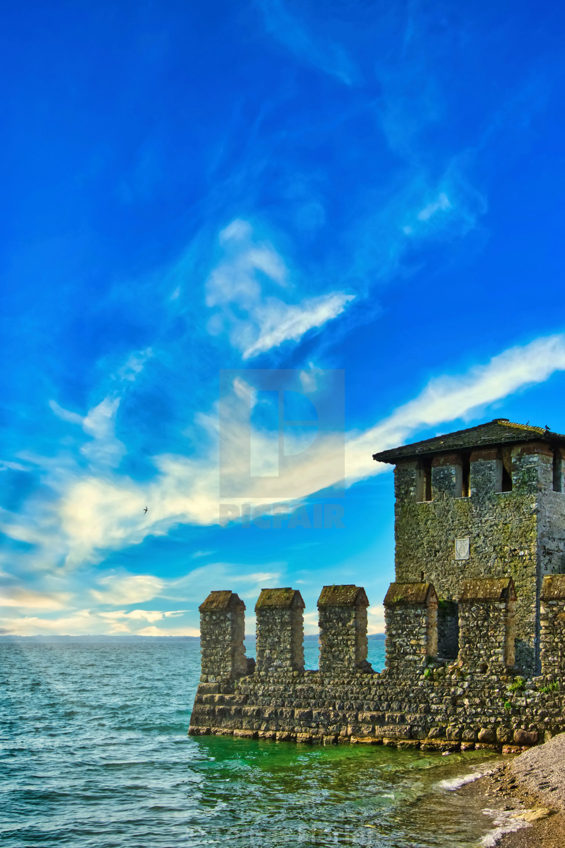 """Water castle on the coast of Lago di Garda in Sirmione"" stock image"