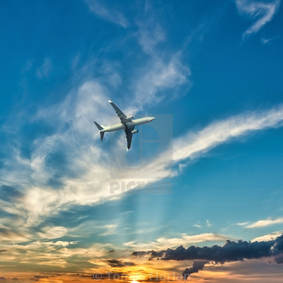 """Airplane above the Kos island with sunset"" stock image"