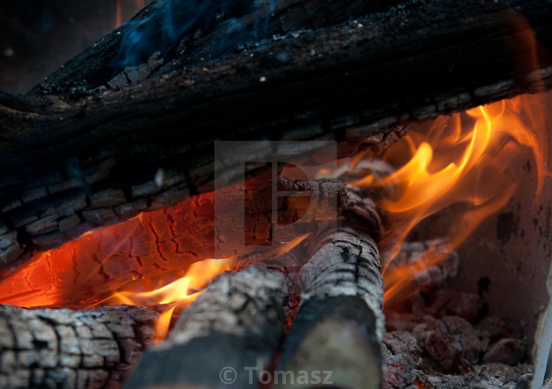 """burning billets in hot stove"" stock image"