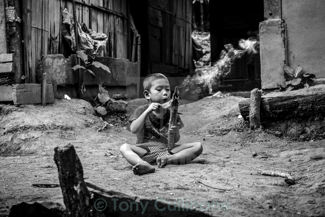 """Boy in Laos Village"" stock image"