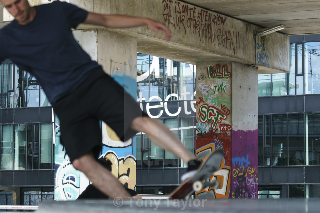 """Close-up jumping skateboarder"" stock image"
