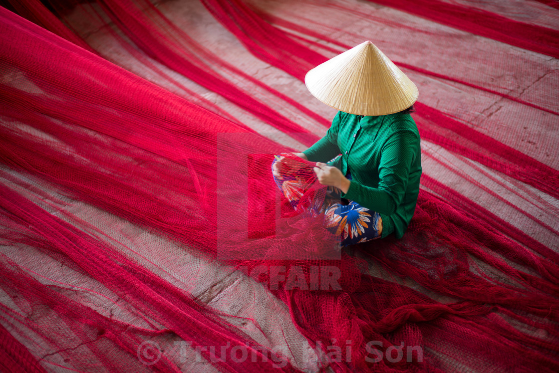 """mending the nets"" stock image"