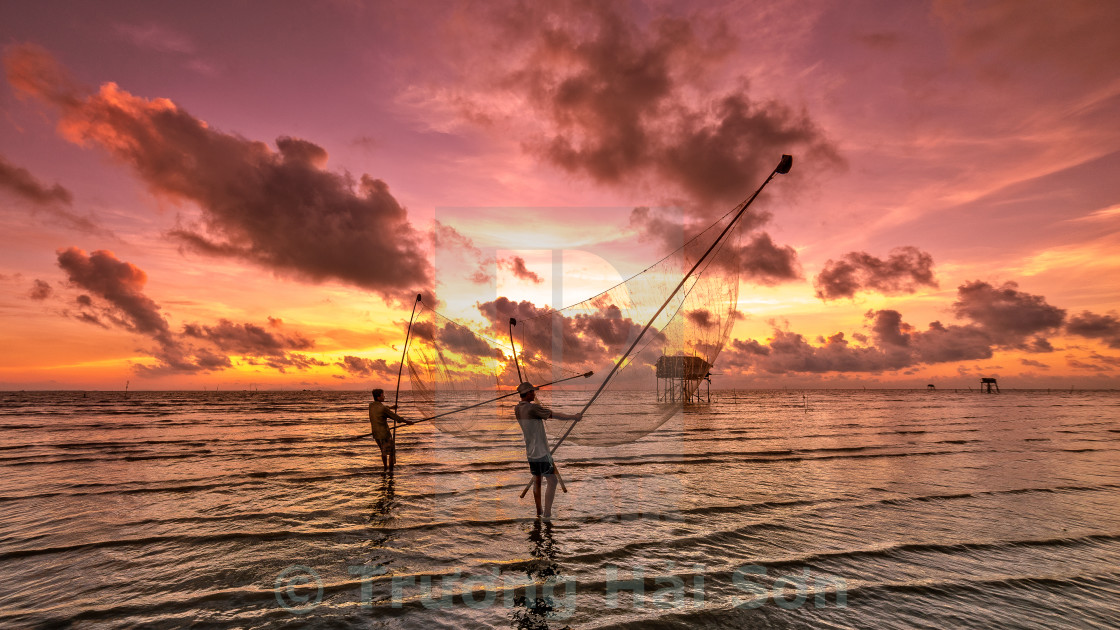 """Catching fish in the sunrise"" stock image"