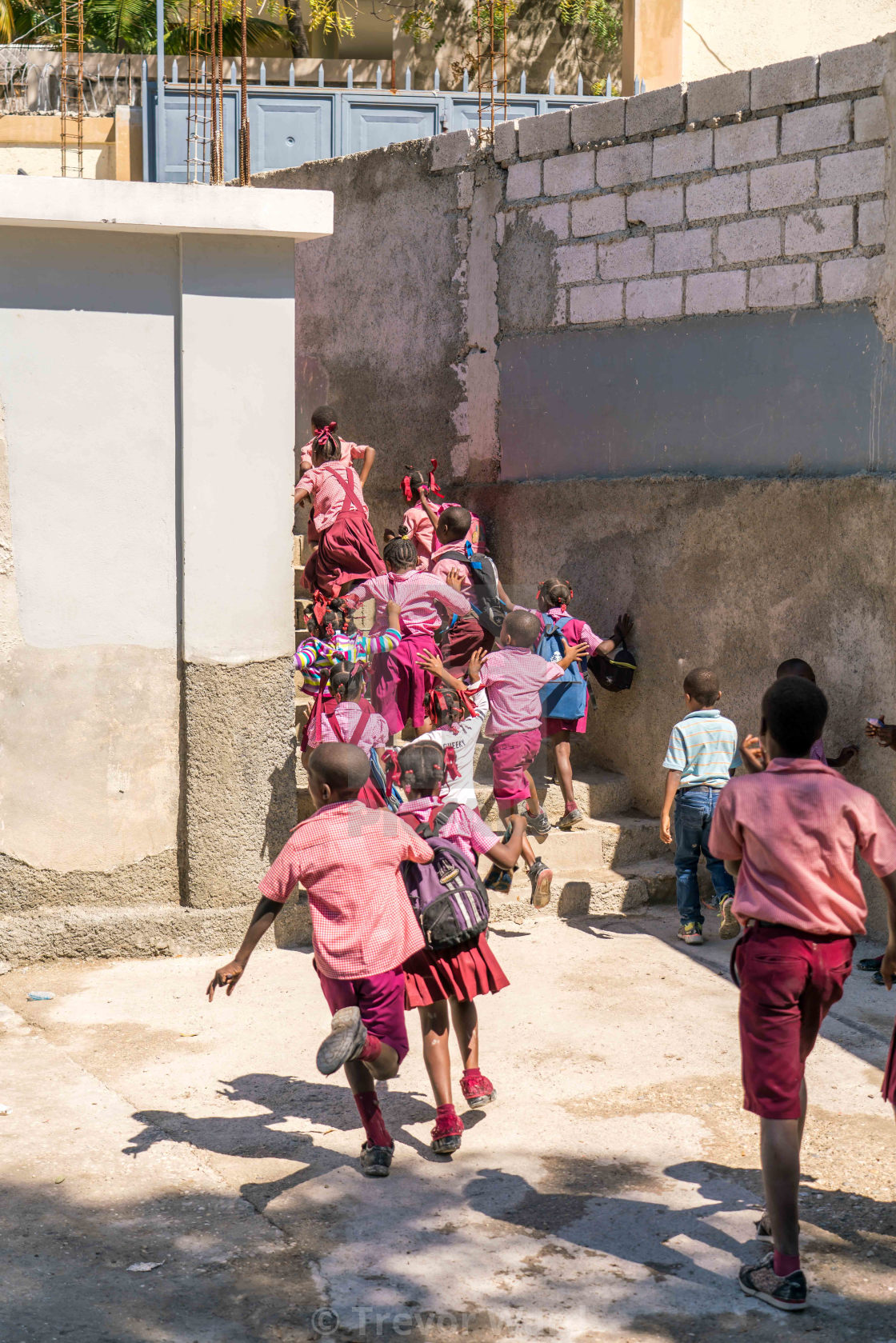 """Haitian school children run up stairs."" stock image"