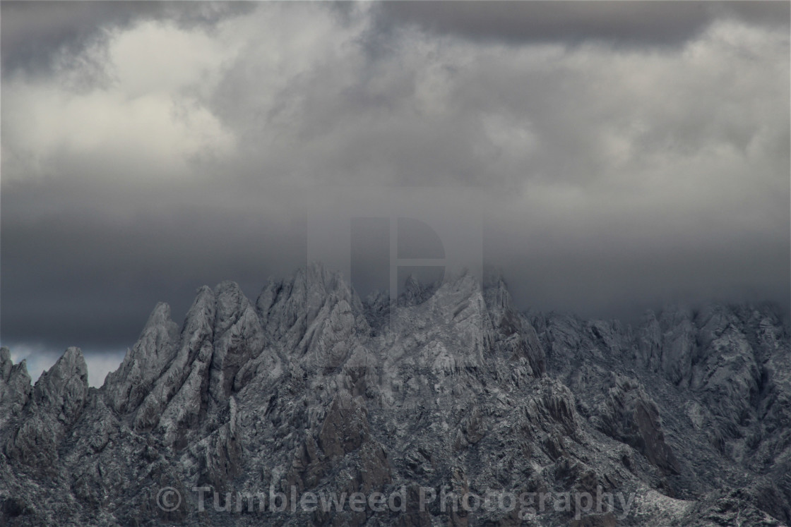 """Snowy Mountain With Clouds"" stock image"