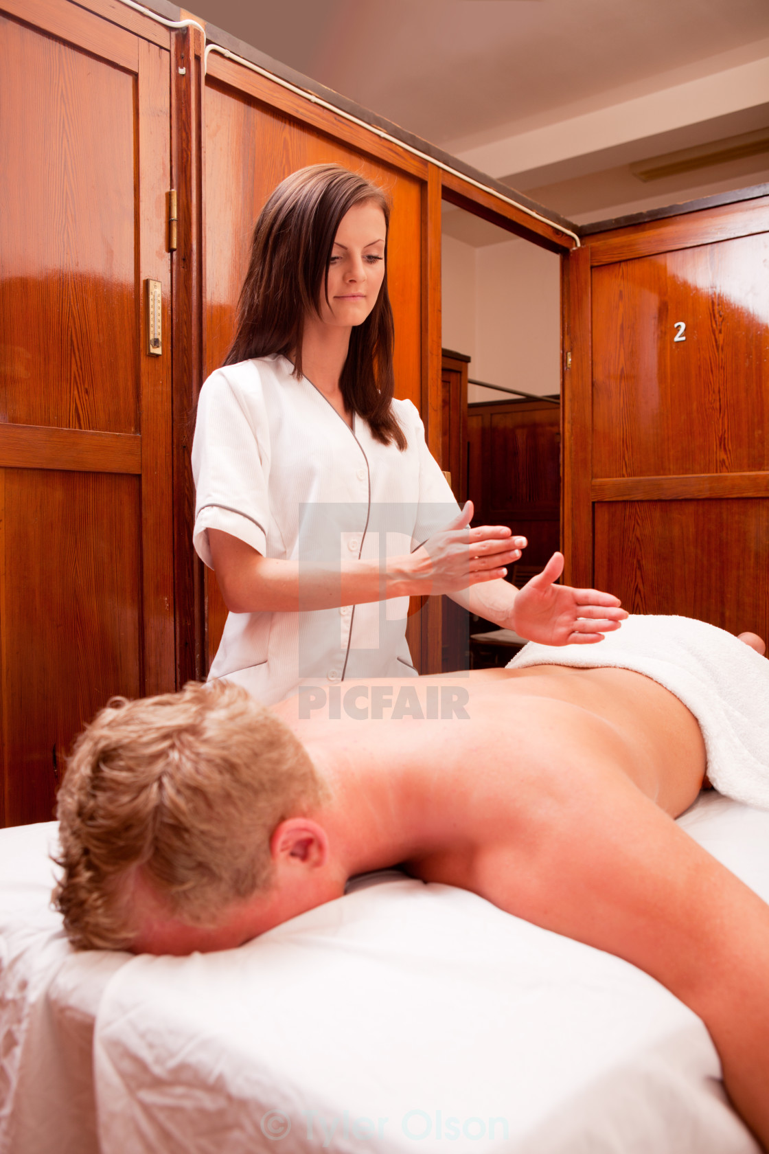 """Woman Giving Percussive Massage"" stock image"