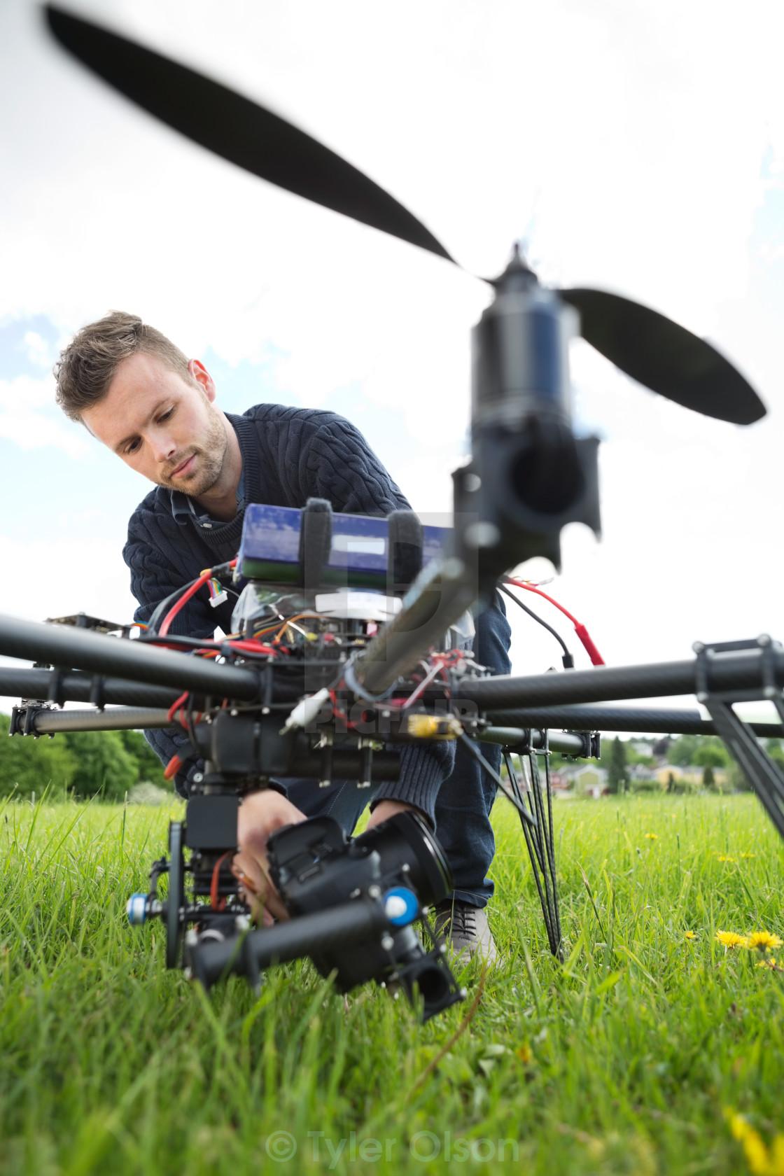 """Technician Fixing Camera On Spy Drone"" stock image"