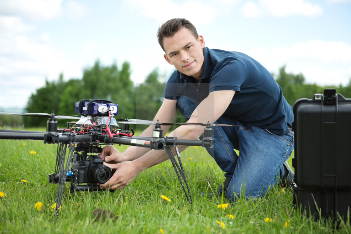"""Engineer Setting Camera On Photography Drone"" stock image"