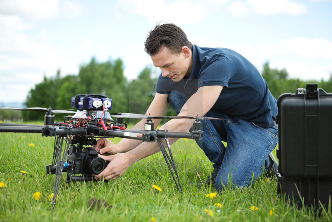 """""""Technician Fixing Camera On UAV Helicopter"""" stock image"""