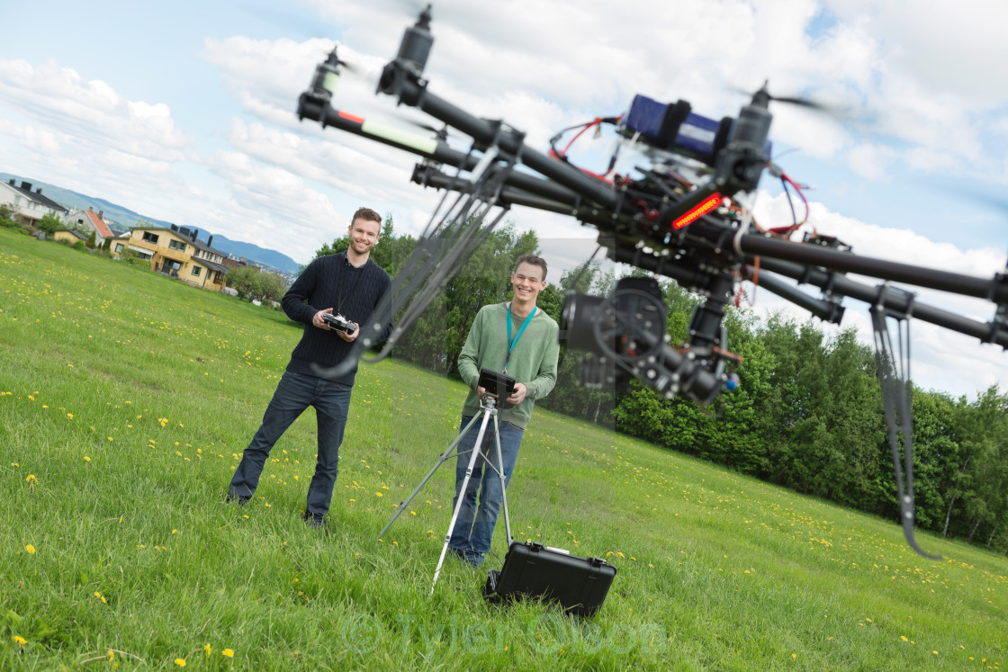 """Engineers Flying UAV Helicopter in Park"" stock image"