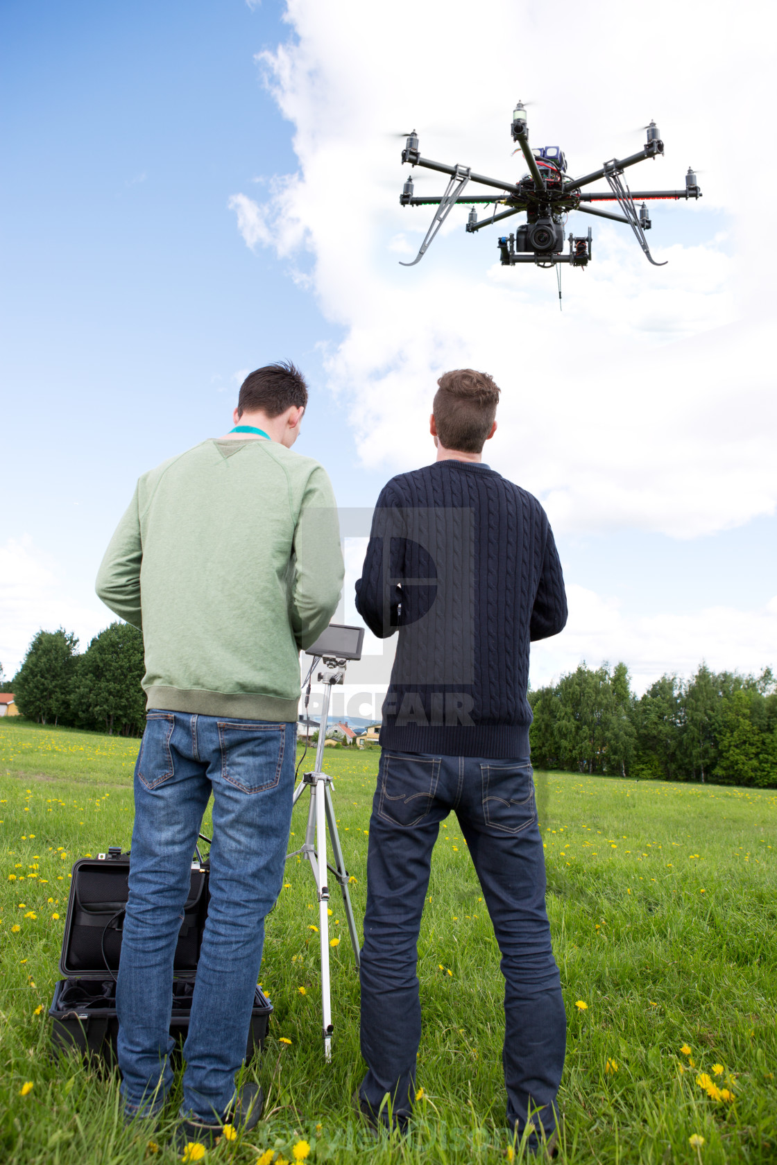 """Photographer and Pilot Operate UAV"" stock image"
