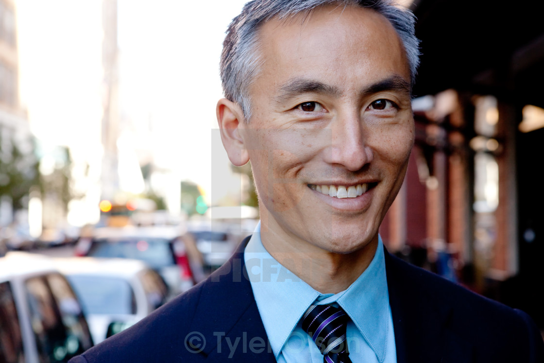 """""""Middle Aged Businessman Standing Outside"""" stock image"""