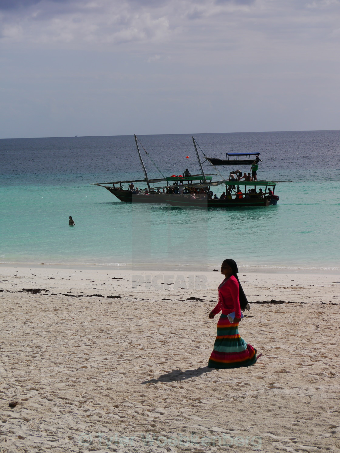 """African woman and dhow"" stock image"