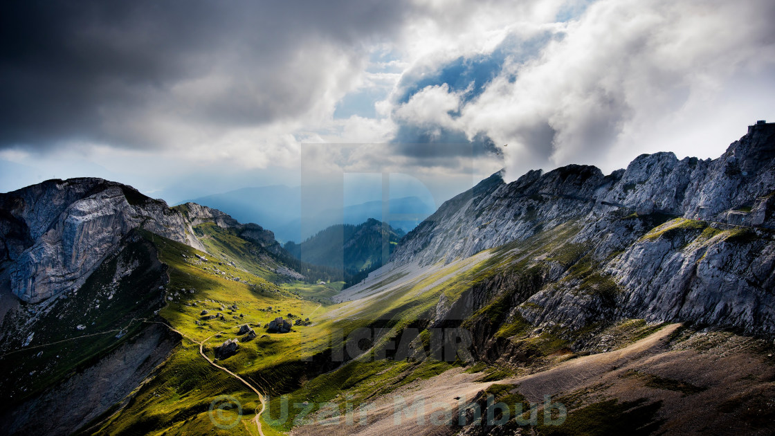 """Clody scene with rocky Mountain below"" stock image"