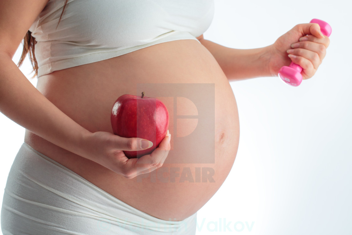 """""""Pregnant Woman Working Out"""" stock image"""
