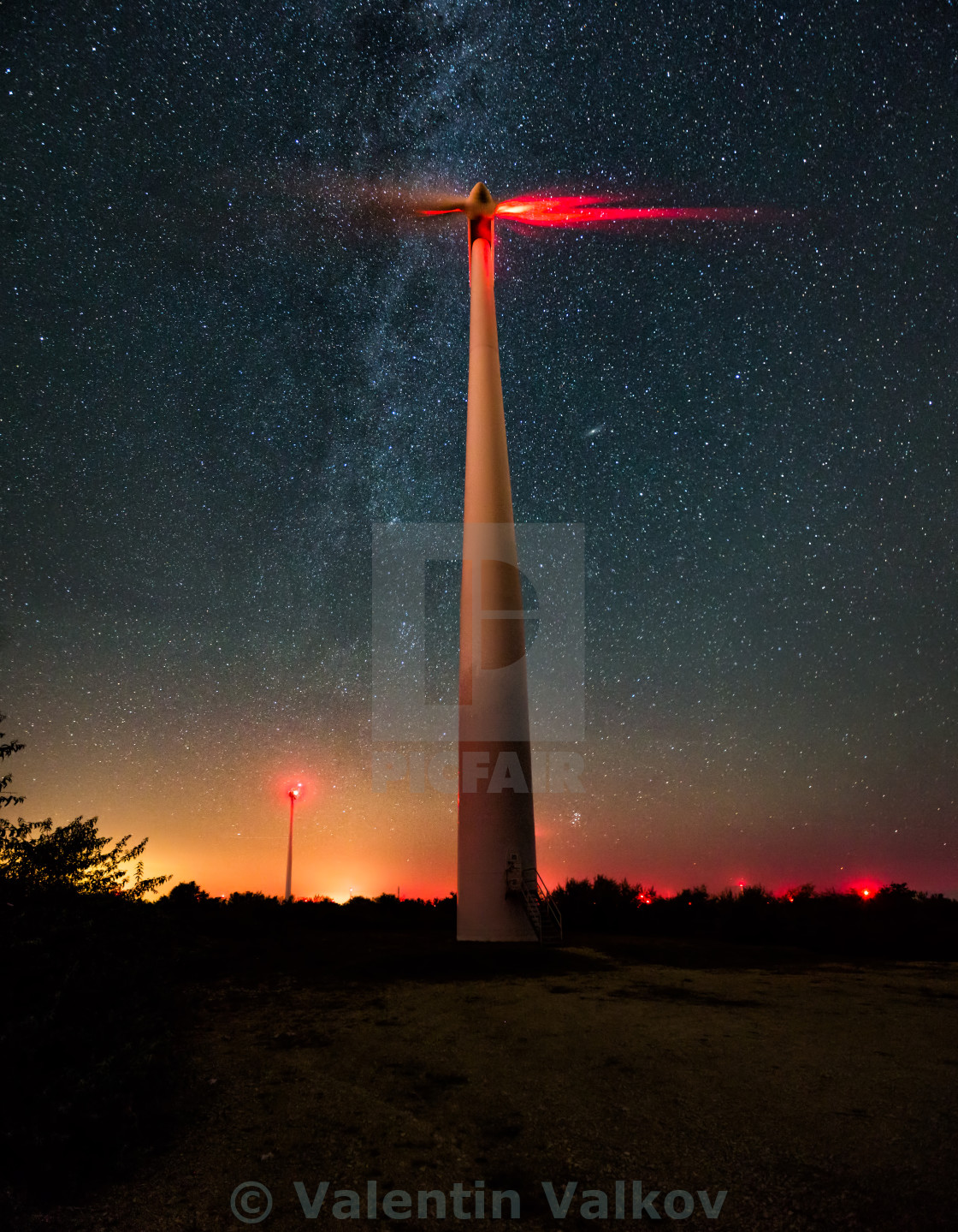 """Wind turbines on the starry night sky with milkyway"" stock image"