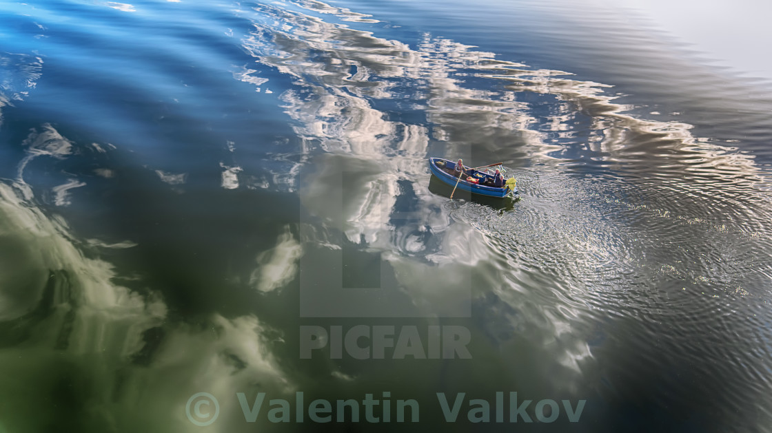 """Aerial view of a wooden boat in the lake"" stock image"