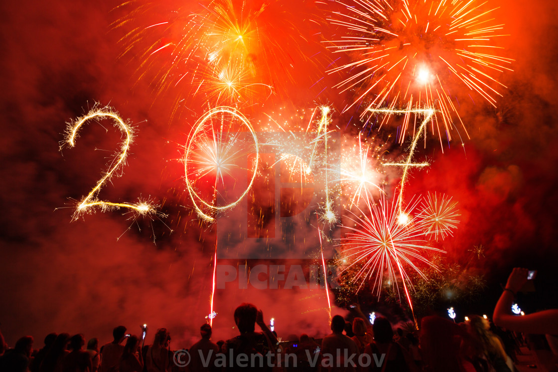 """""""Happy new year 2017 written with Sparkle firework on black backg"""" stock image"""