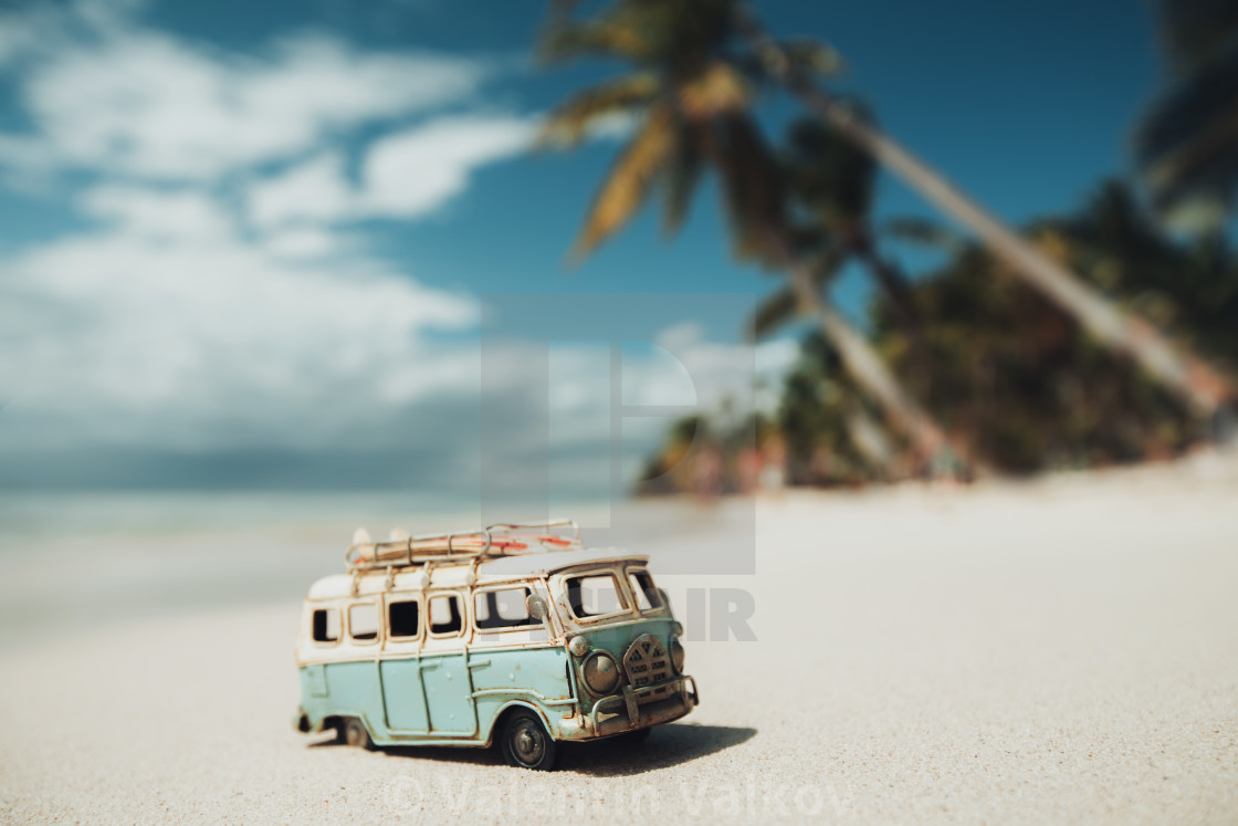"""Vintage miniature van on the tropical beach at sunrise"" stock image"