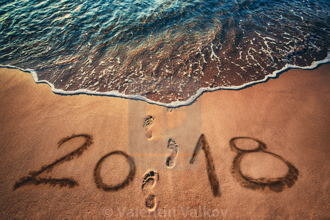 happy new year 2018 concept on the sea beach at sunrise stock image