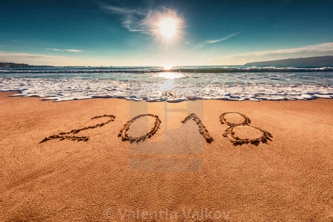 happy new year 2018 concept on the sea beach sunrsie shot stock image
