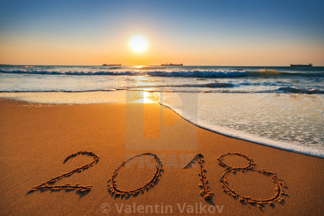 happy new year 2018 concept lettering on the beach sea sunrise stock
